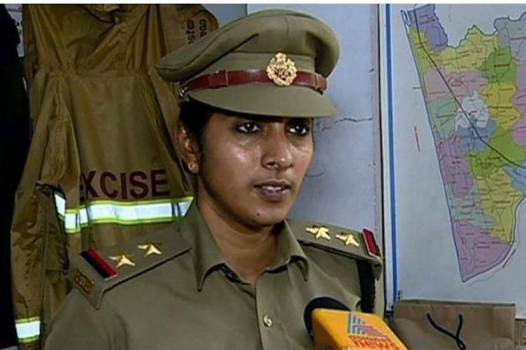 A woman in police uniform being interviewed by the media