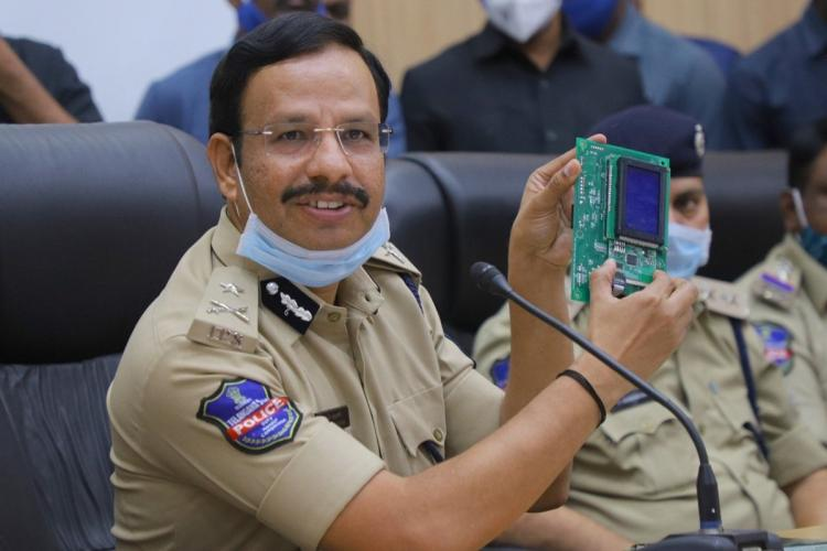Cyberabad police commissioner Sajjanar holds up on the electronic chips that were seized during a press meet