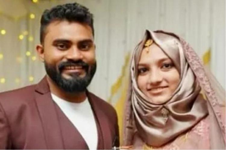Salahudeen in brown suit and Fathima in light brown wedding dress