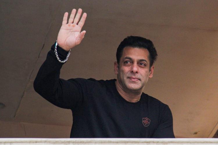 Bollywood actor Salman Khan waves at his fans