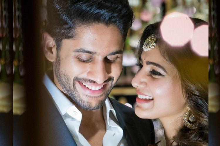 Samantha Akkineni and Naga Chaitanya smiling at each other and looking happy with plenty of lights in the background