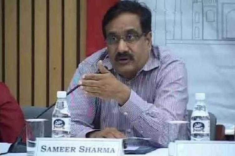 Sameer Sharma sitting on his desk