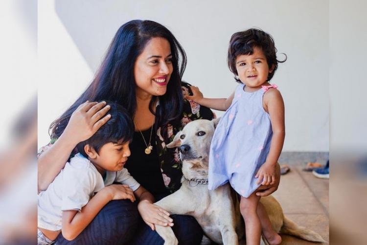 Sameera is seen along with her children in the image