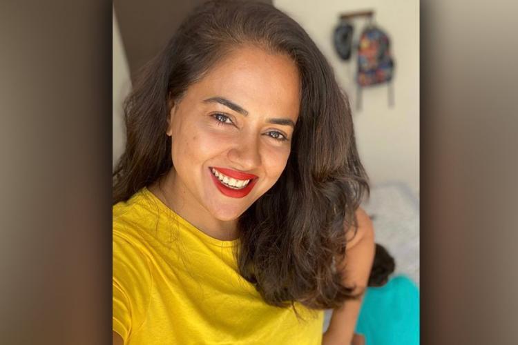 Sameera reddy wearing yellow tee and bright red lipstick