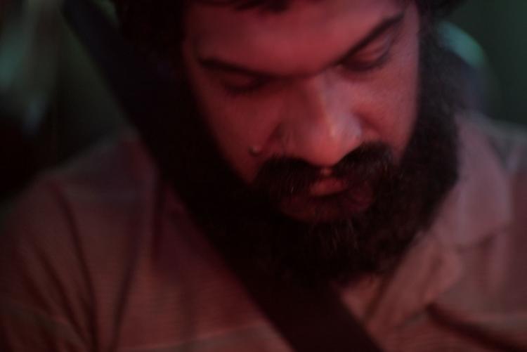 Film maker Sanalkumar Sasidharan looking below