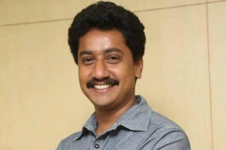 Actor Sanchari Vijay smiling at the camera