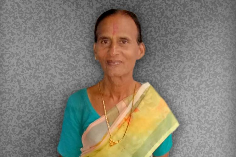 Coimbatore trans woman Sangeetha wearing a yellow saree with a blue blouse smiling directly at the camera