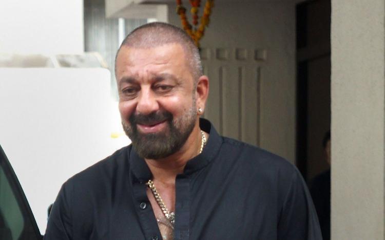 Sanjay Dutt smiling bald