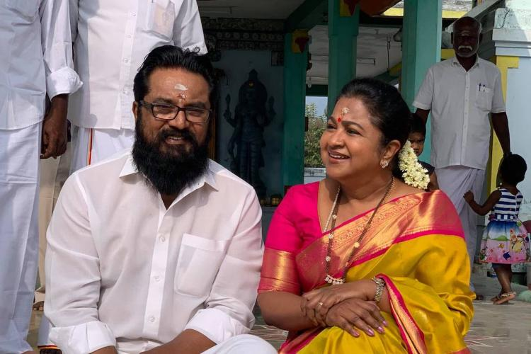 Sarath Kumar and Radikaa outside a temple wearing traditional clothes