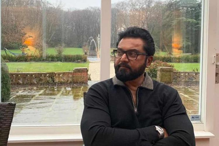 actor sarath kumar wearing a black sweater and sitting