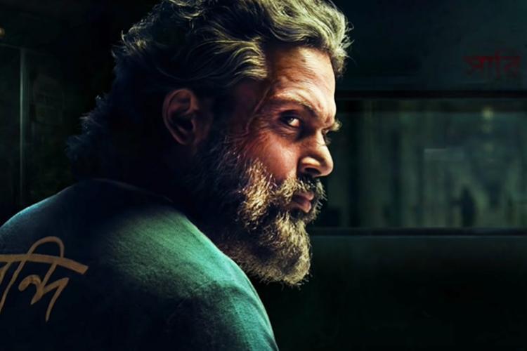 A movie poster Sardar featuring Karthi
