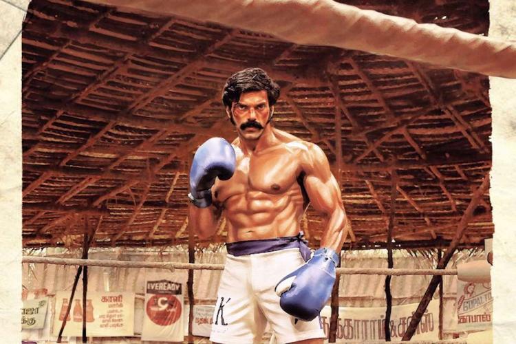 Arya in Sarpatta Parambarai poster wearing boxing gloves and striking a pose