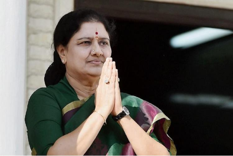 VK Sasikala in a green saree greeting supporters with folded hands