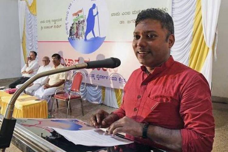 Former IAS Sashikanth Senthil in front of a mic