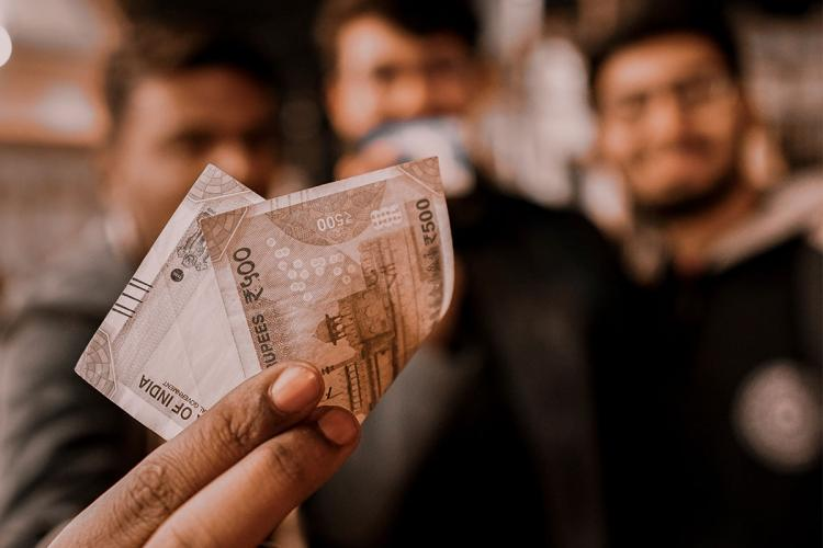 Person holding a Rs 500 note