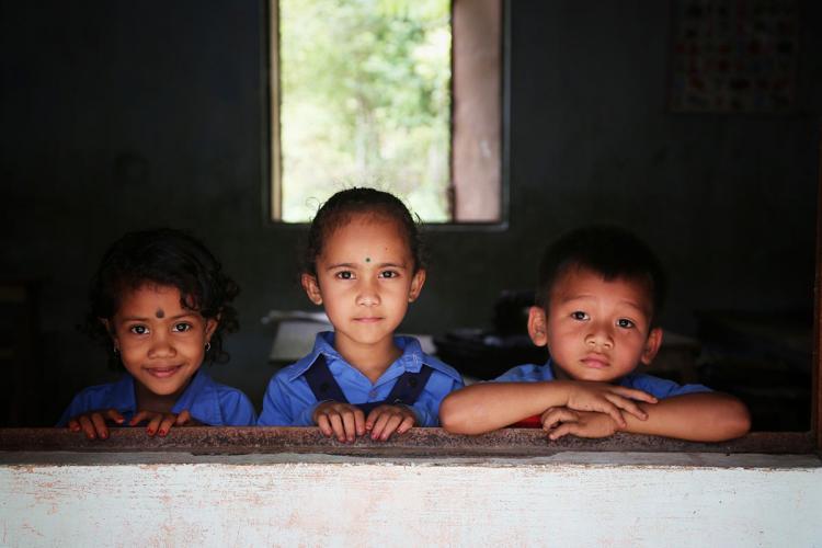 Primary school children at window