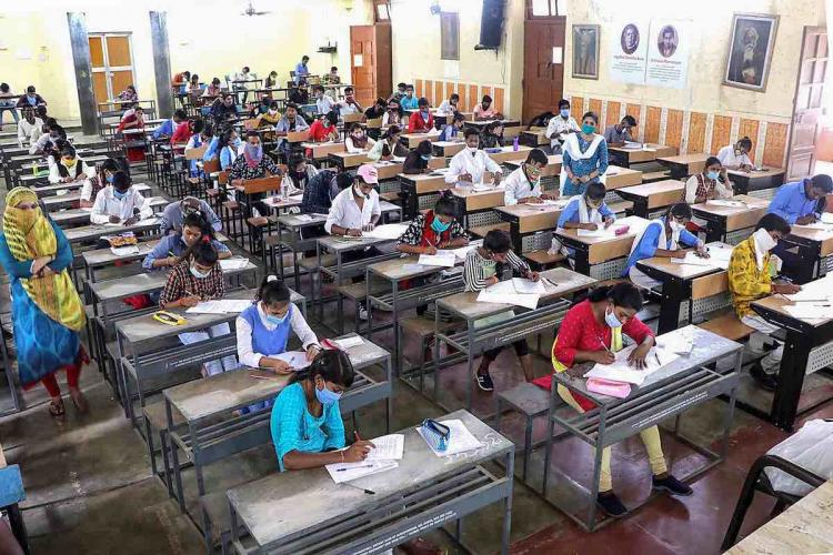 Representative image of students writing an exam