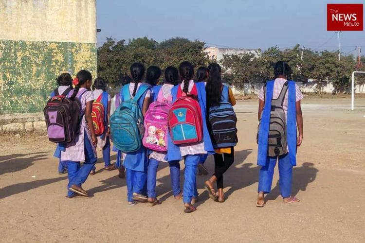Girl students of a government school head to the school while conversing