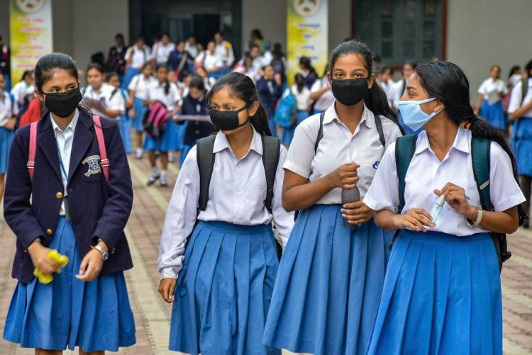 School students with masks and in uniform