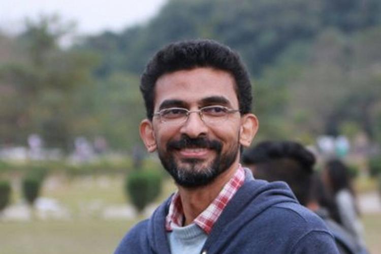 Sekhar Kammula looking away from the camera and smiling