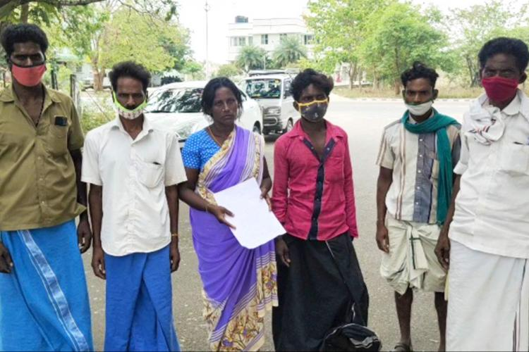 Selvaranis family members wearings masks stand together after handing over a complaint to the police