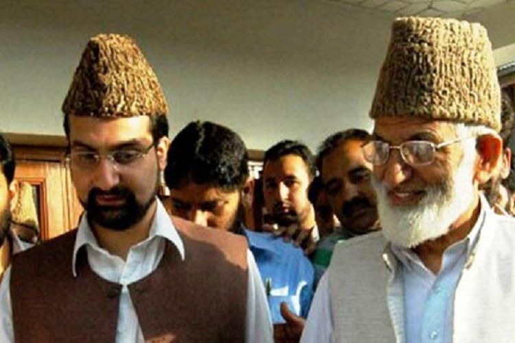 Separatists defy curfew for south Kashmir march detained