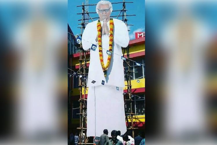 Fans offer milk abhishekam for Vijay Sethupathis cutout
