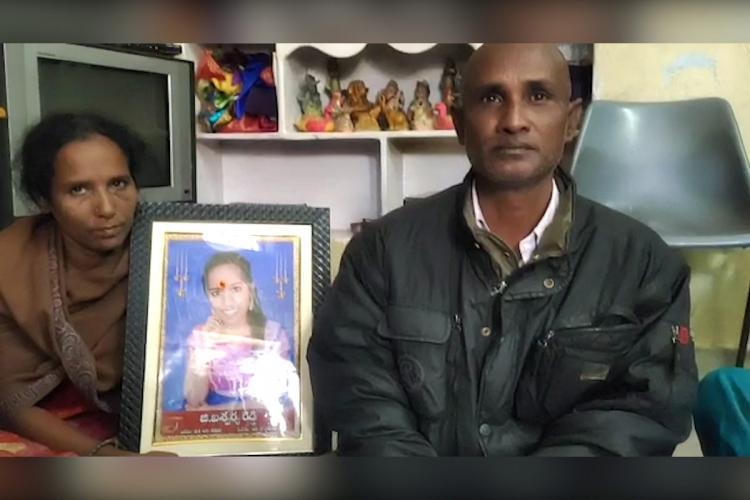 Aishwaryas parents sitting with a photo of Aishwarya