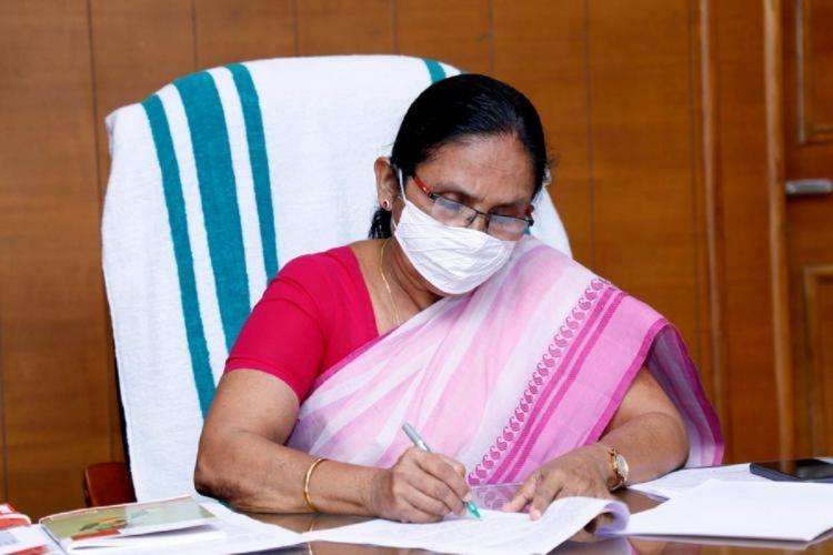KK Shailaja teacher at her office