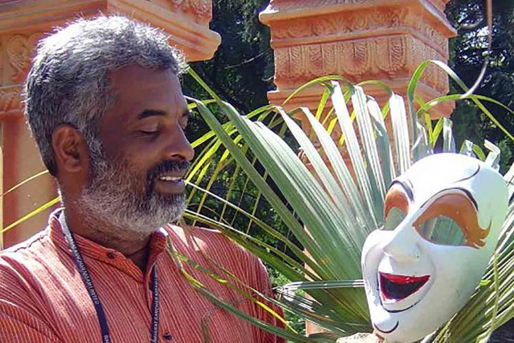 Veteran art director Shashidhara Adapa holding a mask