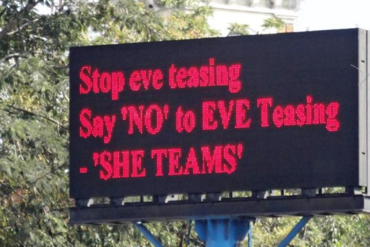 A board that asks people to stop eve teasing