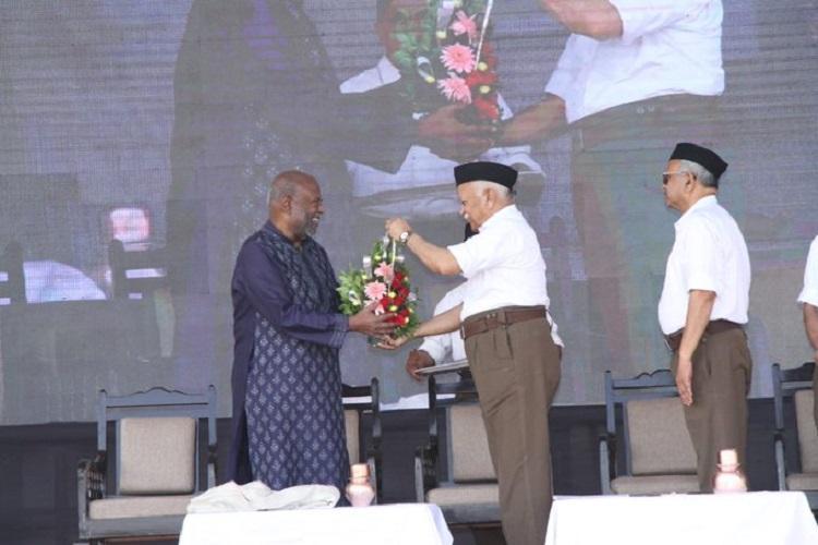 India Inc knocks on RSS door Premji visits Golwalkars samadhi Nadar at RSS HQ