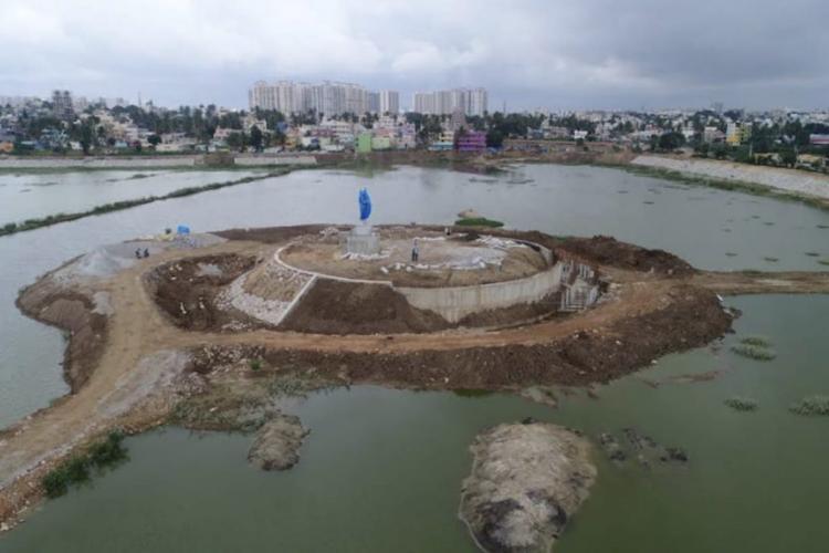 Under construction statue on Begur lake