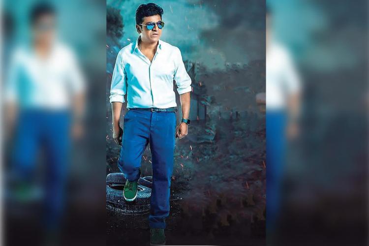 Shiva Rajkumar in white shirt and blue pants
