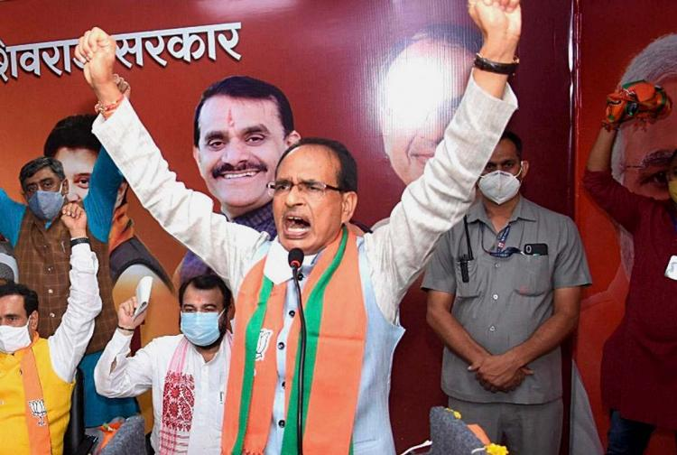 Madhya Pradesh Chief Minister Shivraj Singh Chouhan addresses party workers after inaugurating the partys main election office ahead of the state byepolls