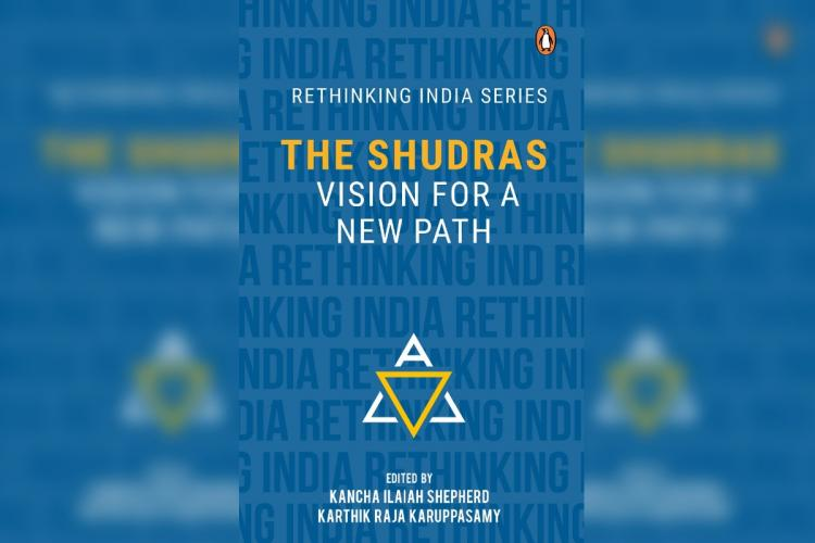 A blue book cover showing the title Shudras Vision for a New Path with blurred images of the same on either side