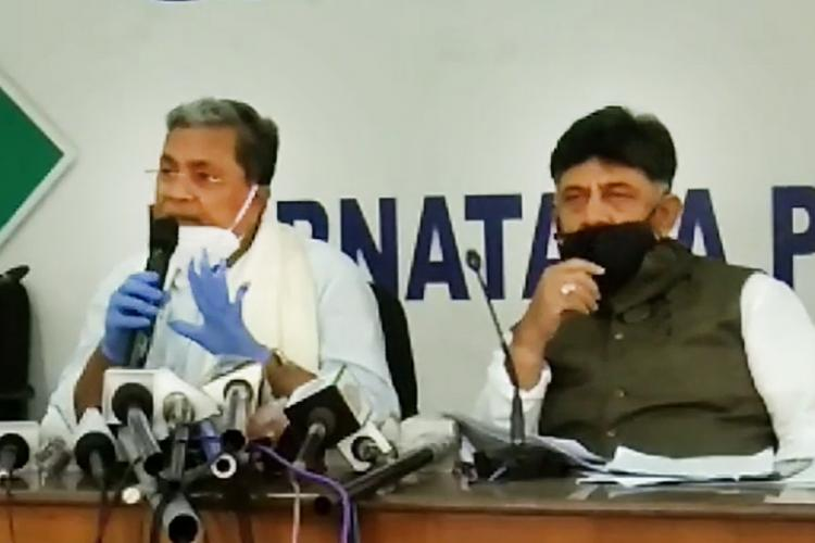 DKS and Siddaramaiah talking to reporters