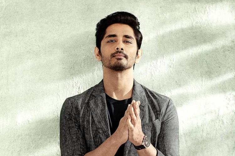Actor Siddharth in a grey blazer