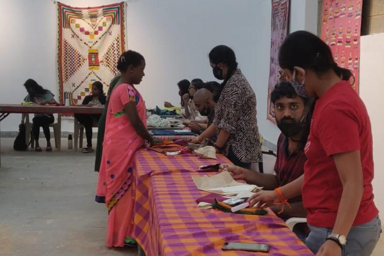 Women of Siddi Community teaching people how to weave the quilts