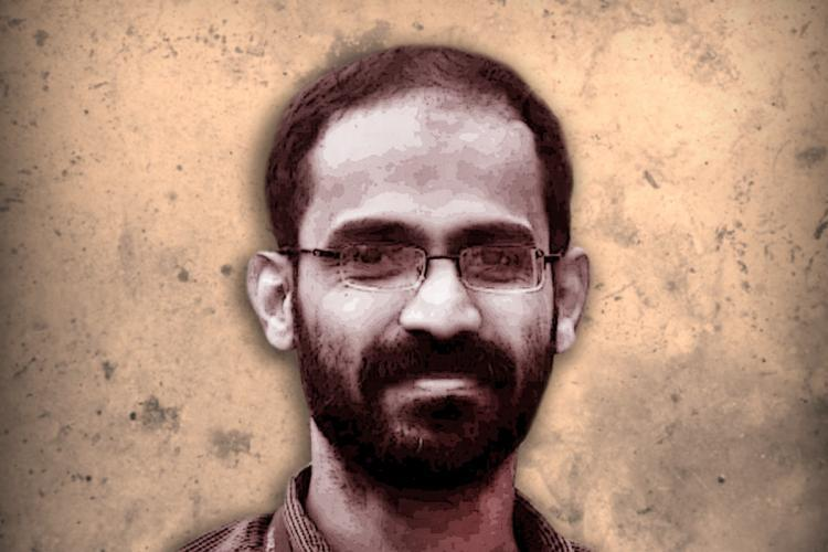Photo Kerala journalist Siddique Kappan He is smiling and looking forward