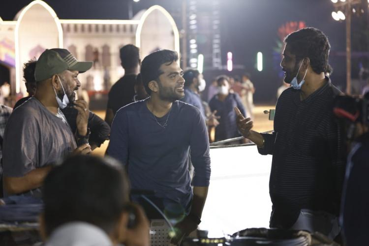 Simbu is seen talking to Venkat Prabhu and another person in the crew