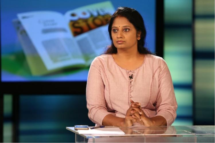 Sindhu Sooryakumar wearing a biege top anchoring Cover story on Asianet News
