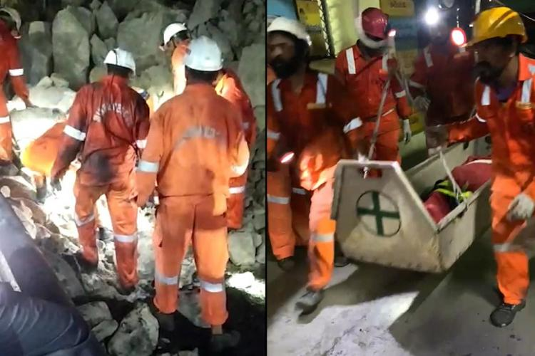 Emergecy rescue teams bringing out the body of the workers who were trapped inside the mine after the roof collapsed