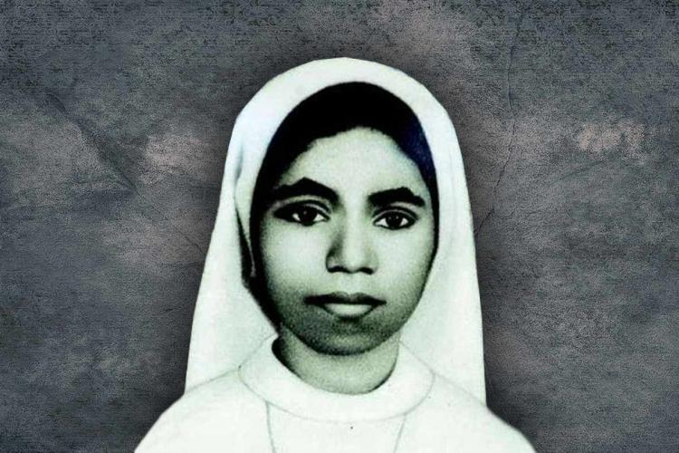 Sister abhaya in a habit with a grey background