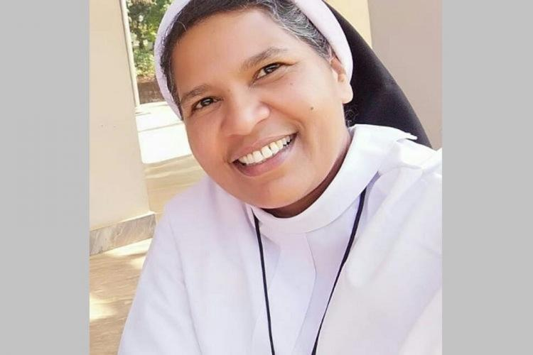 Sister Lucy wearing the religious habit is smiling in this picture