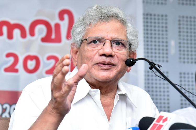 CPI M General Secretary Sitram Yechury wearing a white shirt facing a mike in Kerala during the 2021 Assembly Polls