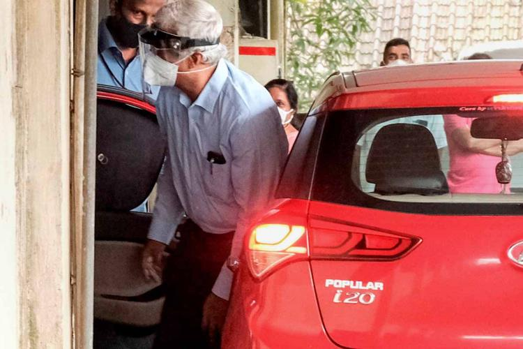 IAS officer M Sivasankar steps out of a car at the ED office where he was questioned for his alleged role in gold smuggling