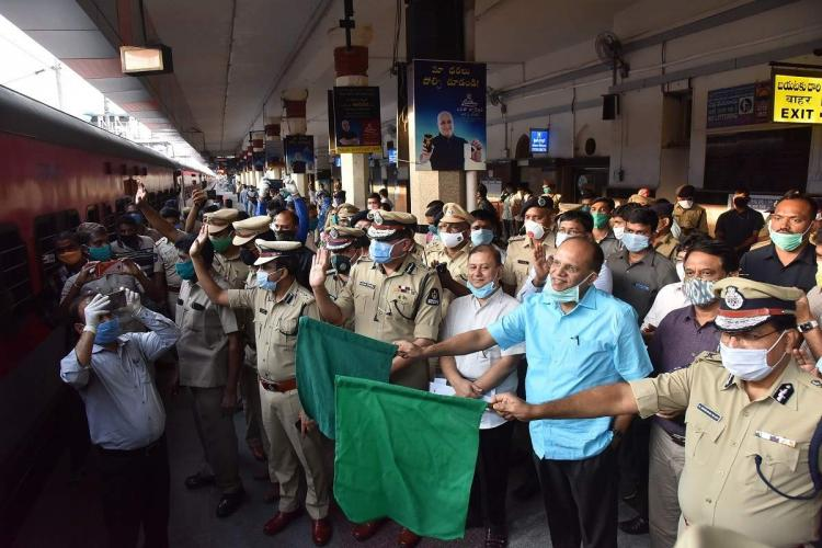Officials of the Telangana government flag off a train carrying migrants to their homes
