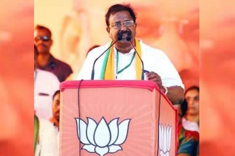 Andhra Pradesh BJP President Somu Veerraju standing at a podium speaking into a mic