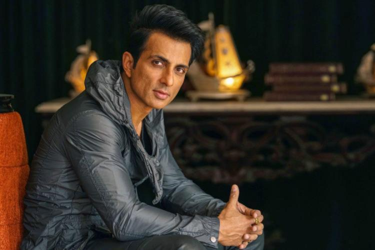 Sonu Sood is seen in a shiny grey tee in the image